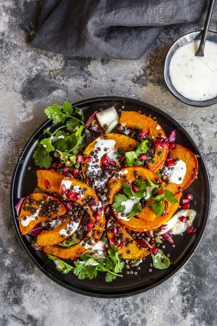 Autumnal salad with fried pumpkin- lentils- radicchio- pomegranate seeds- leaf salad and parsley with dressing