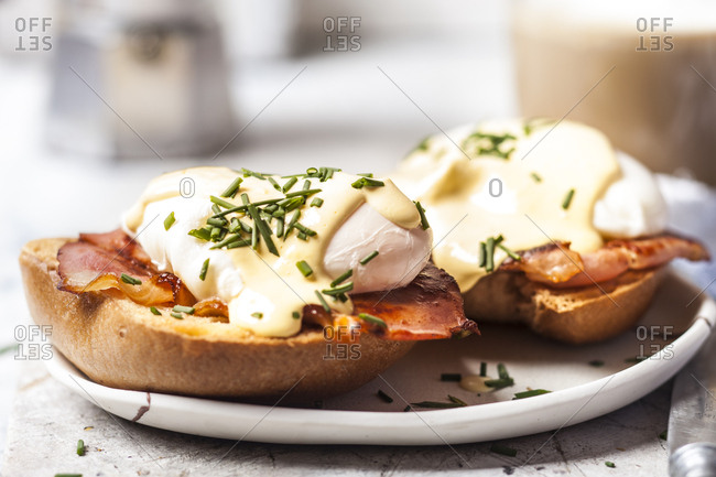 Traditional egg benedict with slices of bacon on toast-  poached egg and hollandaise