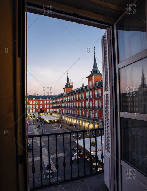 Madrid, Spain - October 10, 2016: View of Plaza Mayor at dusk from window with balcony - vertical