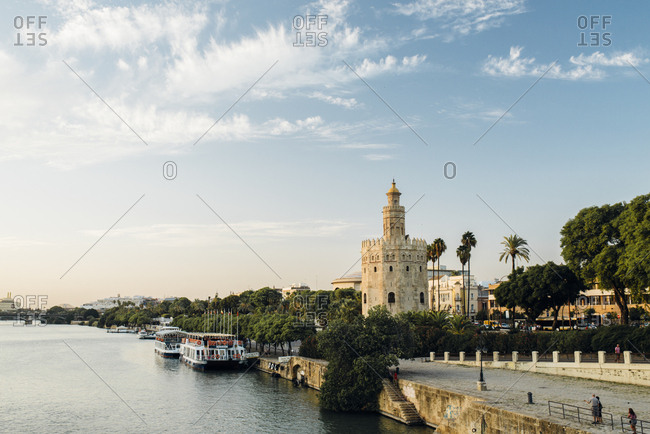Seville, Spain - October 6, 2016: Scene of Torre del Oro next to river - horizontal