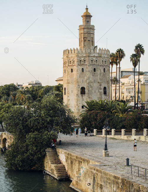 Seville, Spain - October 6, 2016: Scene of Torre del Oro next to river - vertical