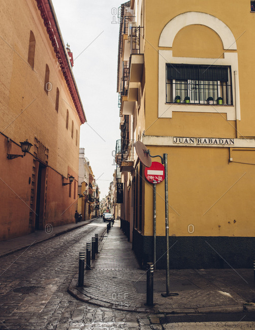 Seville, Spain - October 7, 2016: Street intersection with yellow building