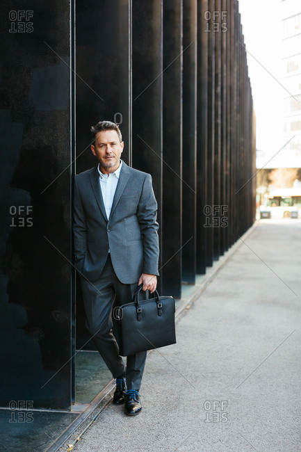 Portrait of a mature businessman in the city looking at camera.