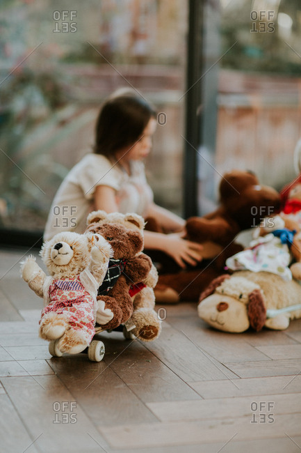 Little girl playing with her stuffed animals