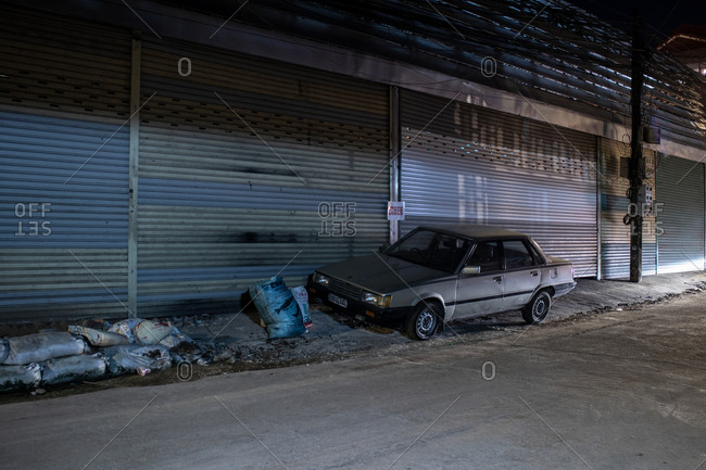Phnom Penh, Cambodia - December 2, 2018: Old car parked along the side of the road