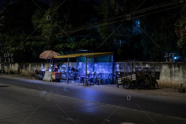 Phnom Penh, Cambodia - December 3, 2018: Empty street food restaurant at night
