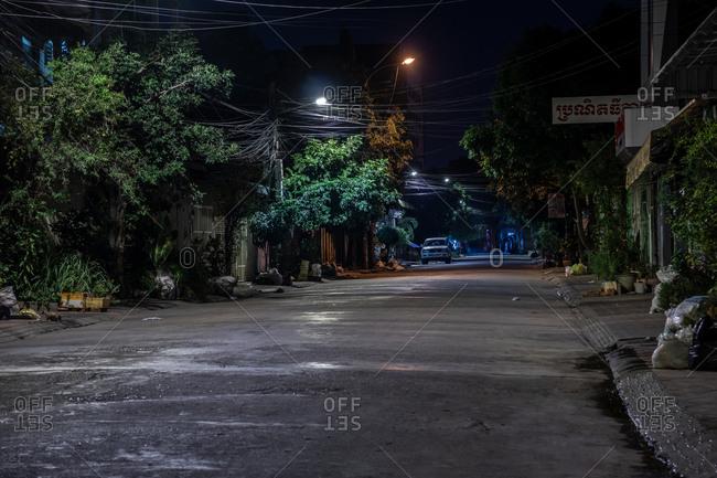 Phnom Penh, Cambodia - December 3, 2018: Car parked along a street at night
