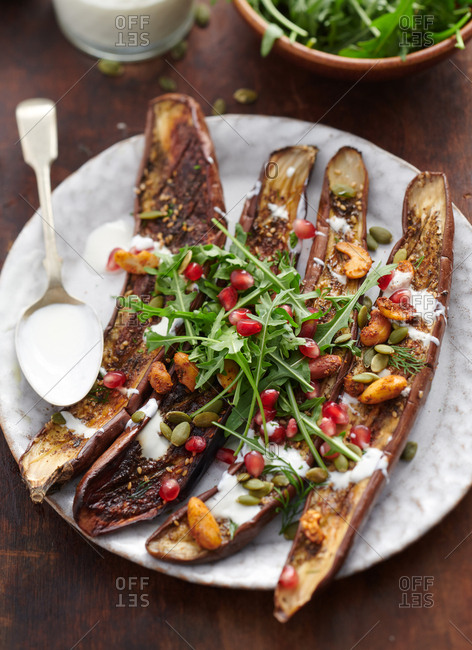 Grilled Asian eggplant salad with arugula and pomegranate seeds