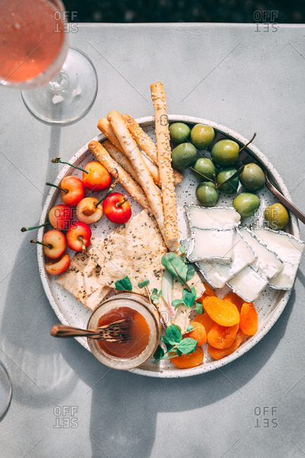 Small cheeseboard platter outside on sunny summer day