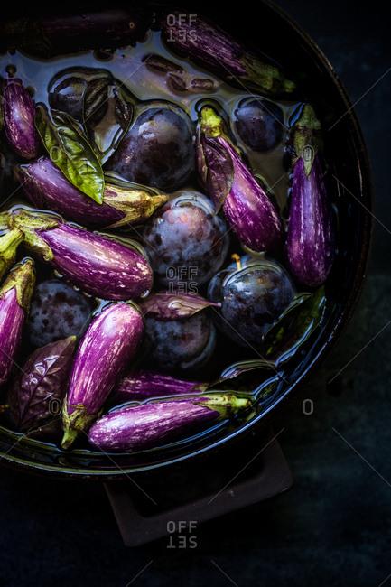 Dark photo of eggplant and plum purple vegetables