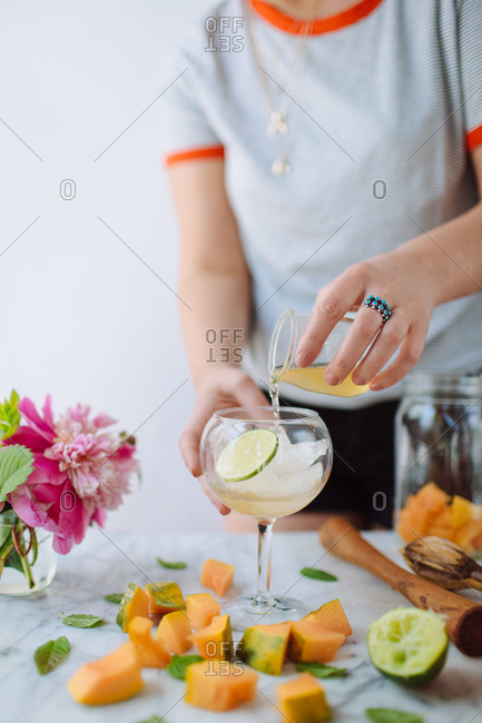 Cocktail being made with lime and simple syrup