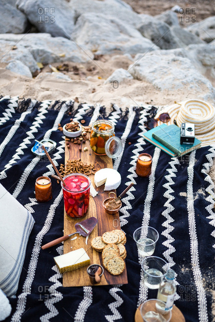 Picnic on the beach with rocks and sand