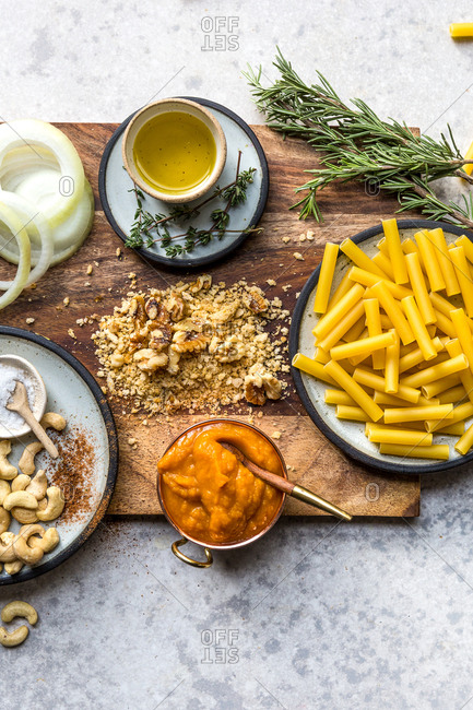 Pasta dish ingredients on a wooden cutting board