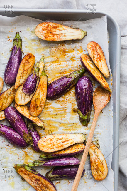 Cut eggplants on baking sheet ready to go into oven for baking