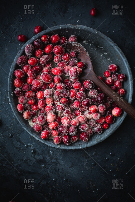 Sugared cranberries on dark background