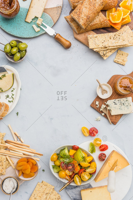 Cheeseboard and appetizer spread with space in middle for text
