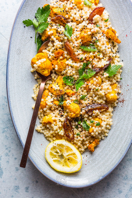 Couscous and cauliflower salad in oval blue bowl