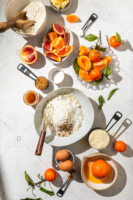 Fruit and ingredients on white marble background