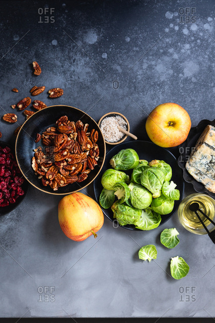 Salad ingredients for winter salad laid out on blue background