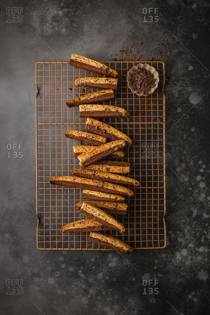 Chocolate and coffee biscotti pieces on gold cooling rack