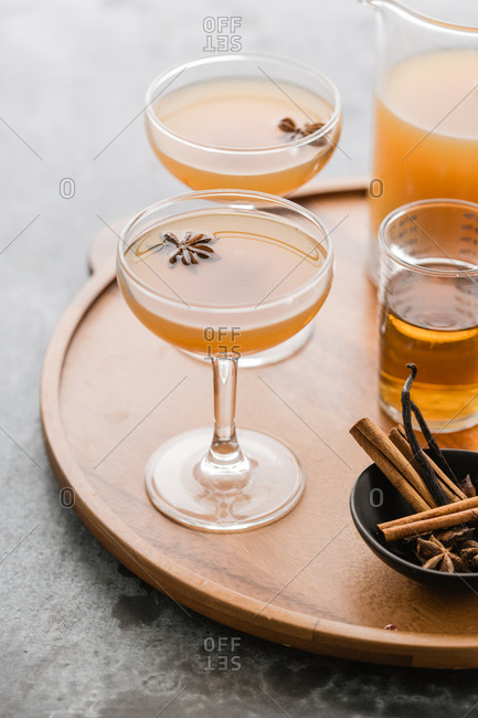 Apple cider cocktails on tray with start anise