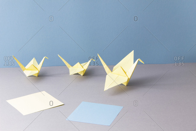 Origami- cranes and paper