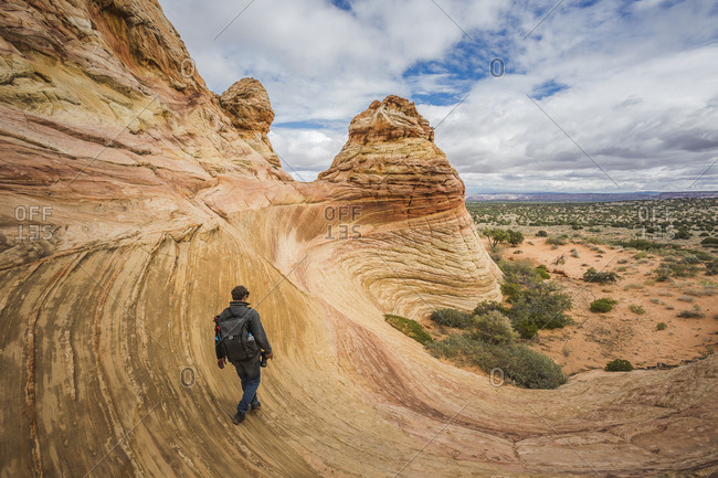 USA- Arizona- Kanab-  Coyote Buttes- man walking down