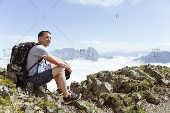 Austria- South Tyrol- hiker looking at view
