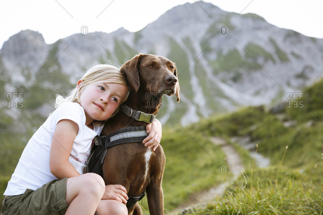 Austria- South Tyrol- young girl with her dog