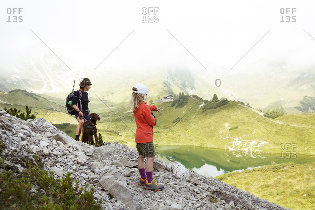 Austria- South Tyrol- mother- daughter and dog on hiking trail