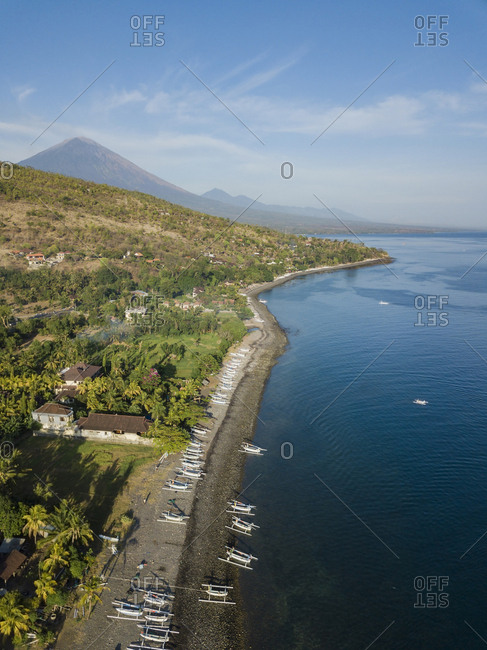 Indonesia- Bali- Amed- Aerial view of Lipah beach and volcano Agung