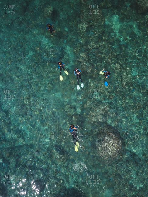 Indonesia- Bali- Divers in ocean at Amed beach