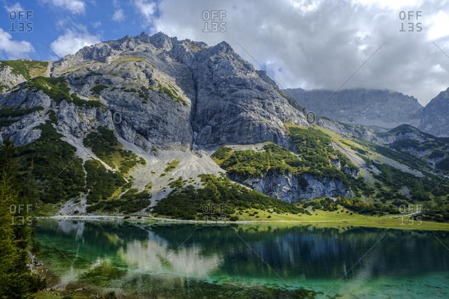 Austria- Tyrol- Wetterstein Mountains- Mieminger Kette- Ehrwald- Lake Seebensee and Vorderer Tajakopf