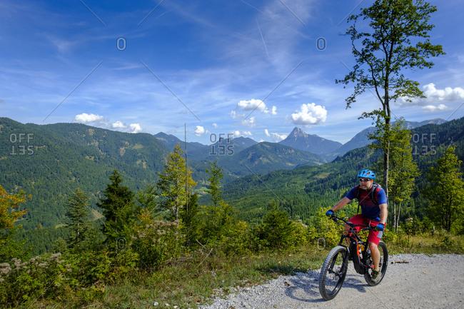 Austria- Tyrol- Juifen- Rotwand mountain pasture- mature men on mountain bike