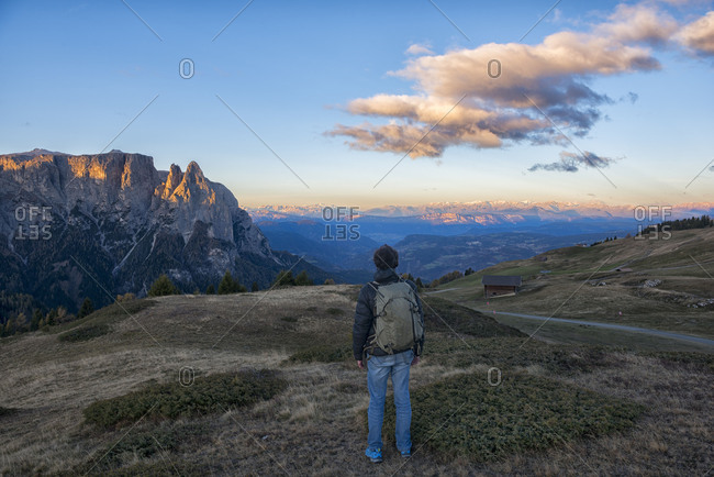 Italy- South Tyrol- Seiser Alm- Hiker in front of Schlern at sunrise