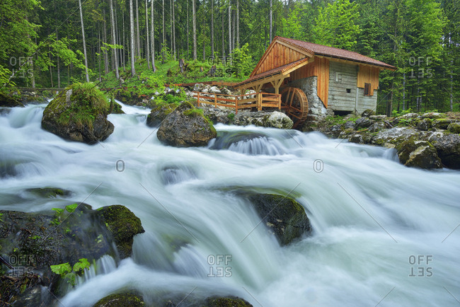 Old Mill at the river Schwarzbach near the famous Golling waterfall in spring- Austria