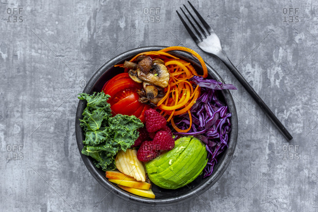 Kale avocado salad with red cabbage- tomato- fried mushroom- carrot- apple and raspberry