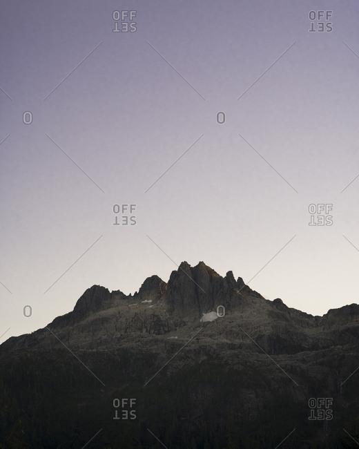Dramatic view of mountain peak at sunset