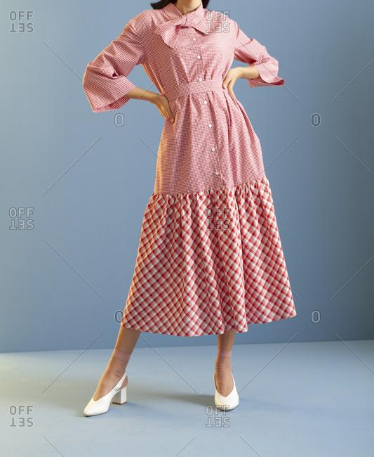 Studio shot of a model wearing checkered dress