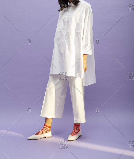 Model wearing white culottes and shirt