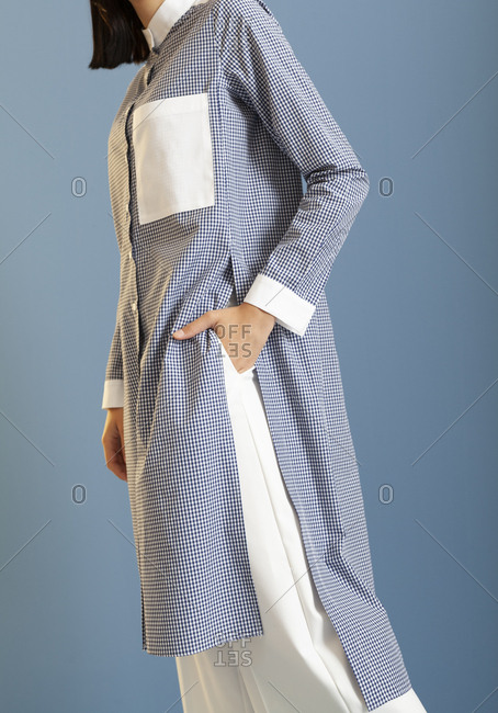 Studio shot of model wearing checkered shirt