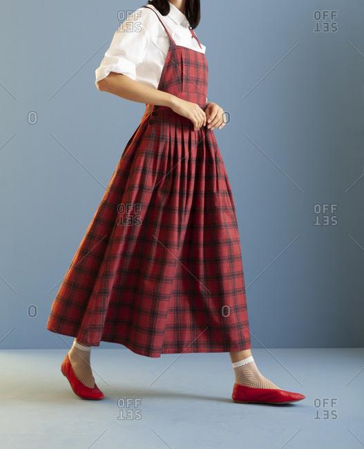 Studio shot of a model wearing a checkered dress