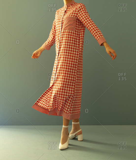 Studio shot of a model wearing checkered dress