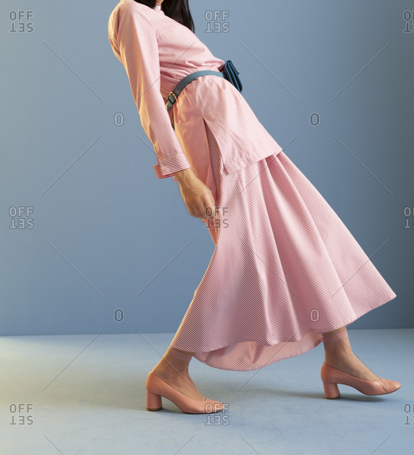 Studio shot of a model wearing pink skirt and shirt