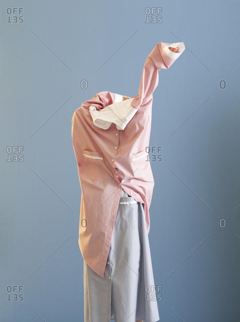 Model trying to wear a dress on a dress