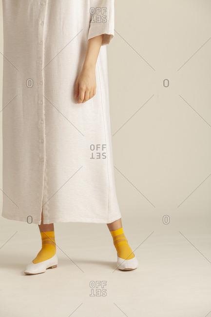 Studio shot of a model wearing a long dress