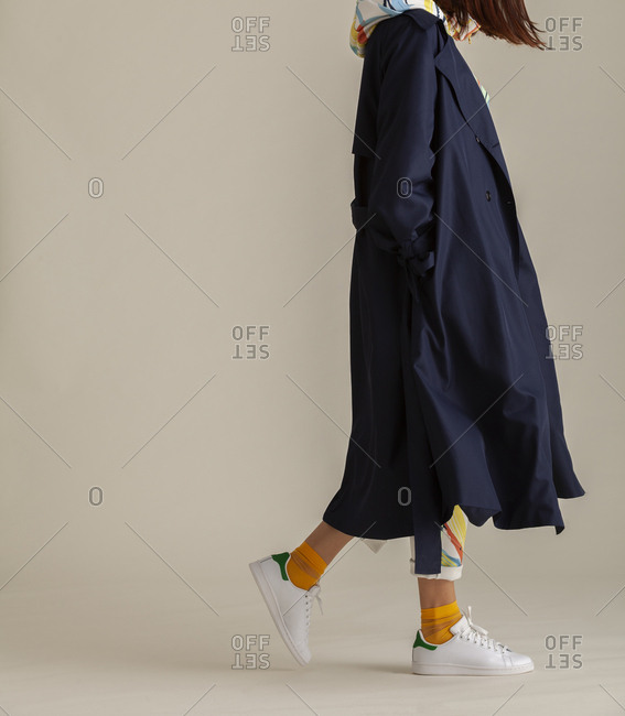 Studio shot of a model with dark blue trench coat
