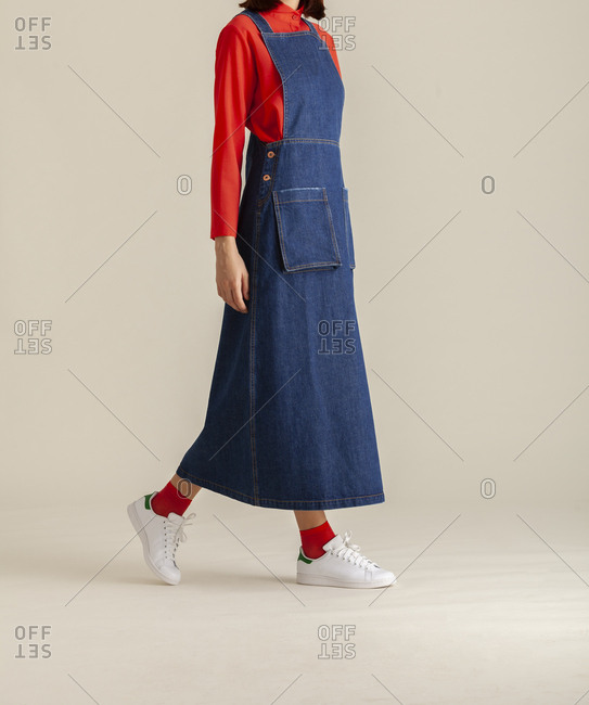 Studio shot of a model wearing a long jean dress