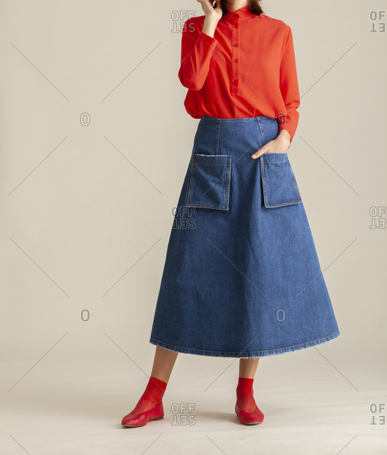 Studio shot of a model wearing a long jean skirt