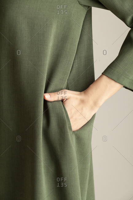 Detail studio shot of model wearing a green dress